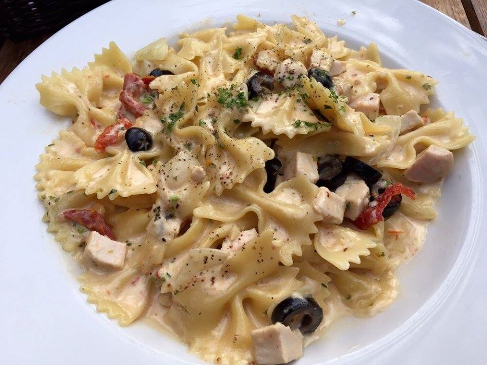 Bowl of bowtie pasta with cream sauce and chicken