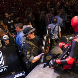Characters chat after the Salt Lake Comic Con kickoff news conference at the Salt Palace Convention Center in Salt Lake City, Thursday, Sept. 4, 2014.