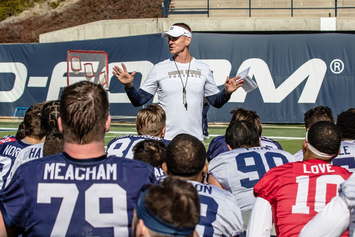 Utah State football coach Gary Andersen talks to the team during spring camp at Maverik Stadium in Logan.