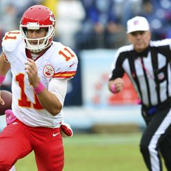 Oct 6, 2013; Nashville, TN, USA; Kansas City Chiefs quarterback Alex Smith (11) runs with the ball against the Tennessee Titans during the second half at LP Field. The Chiefs beat the Titans 26-17.