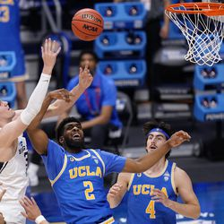 BYU forward Matt Haarms, left, battles for a rebound with UCLA forward Cody Riley (2) and teammate Jaime Jaquez Jr. (4) during the first half of a first-round game in the NCAA college basketball tournament at Hinkle Fieldhouse in Indianapolis, Saturday, March 20, 2021.