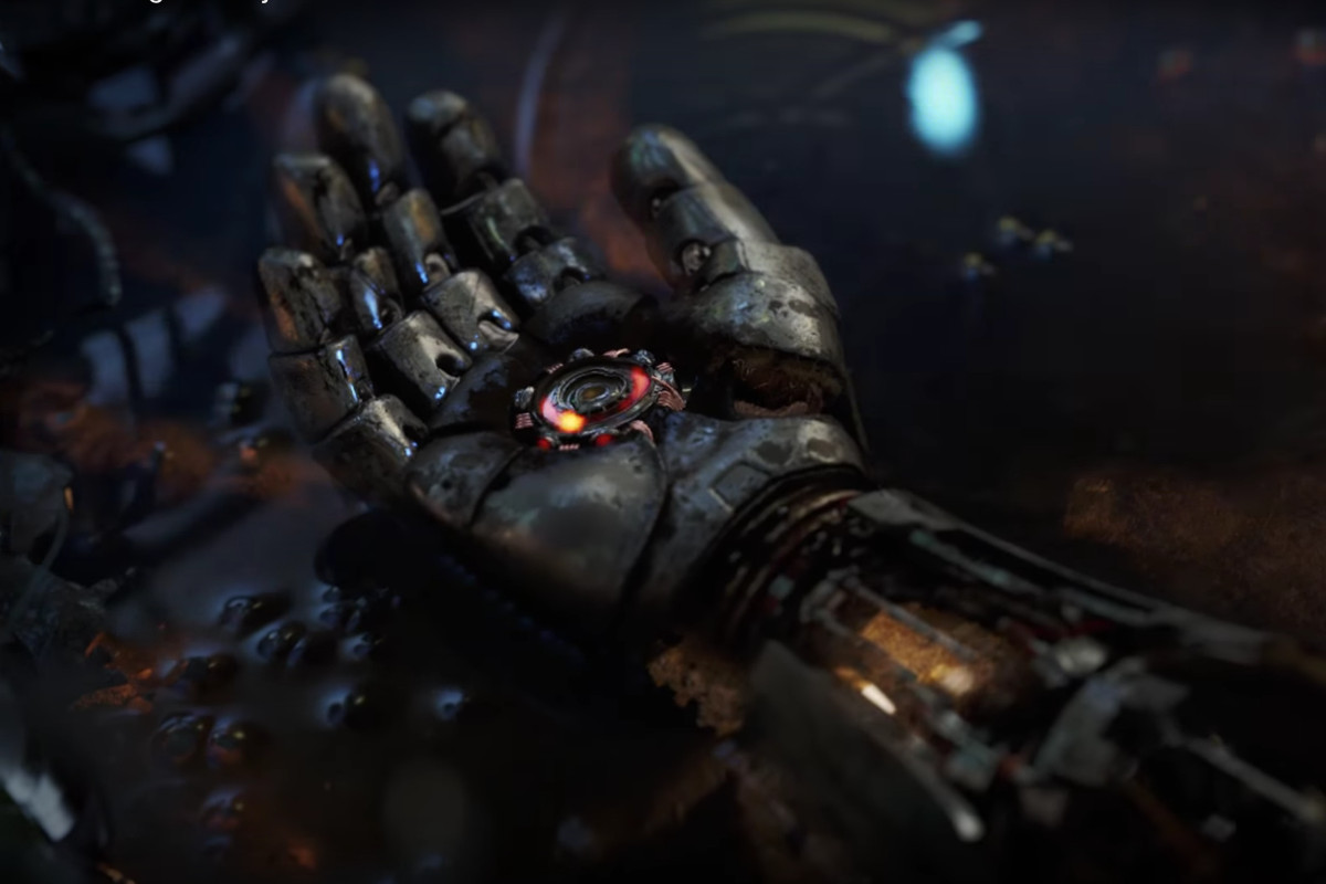 Iron Man's glove flickers to electric life.