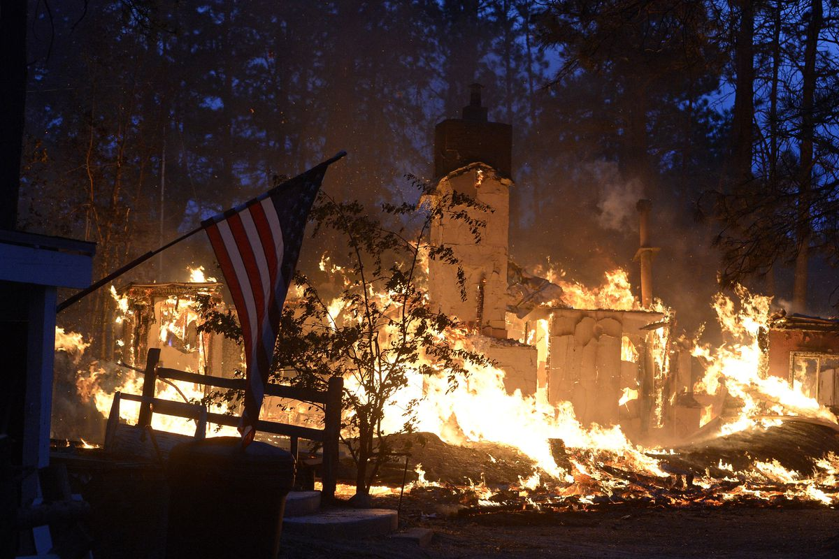 A house is fully engulfed with flames in the midst of the Black Forest Fire northeast of Colorado Springs on June 12, 2013.