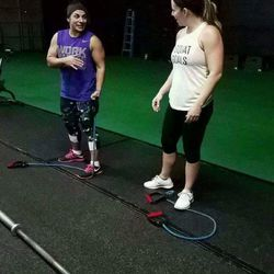 Memorez Rackley, white shirt, who was killed in a shooting Tuesday, works out with Nicole Martinez at Pure Workout. The gym will host two workouts to celebrate her life and raise money for her family on Saturday at 8 a.m. and Sunday at 9 a.m.