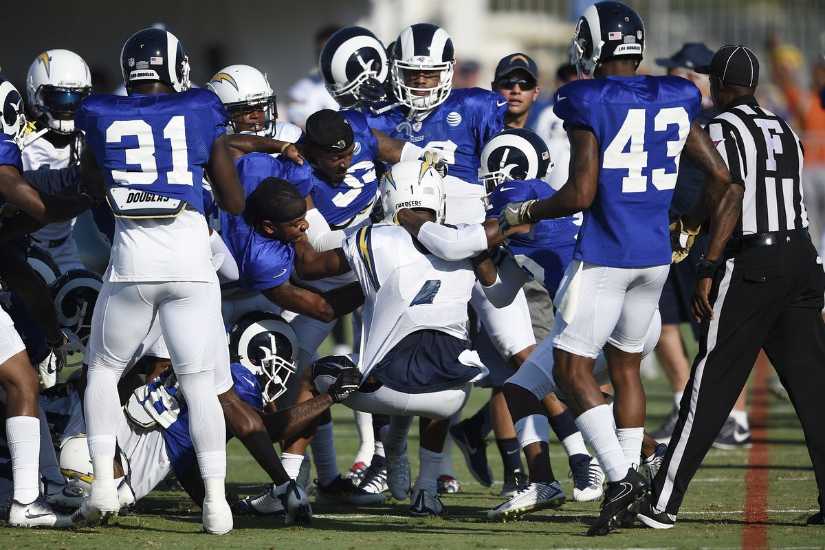 The Los Angeles Rams and Los Angeles Chargers scuffle during a joint practice in training camp, Aug. 9, 2017.