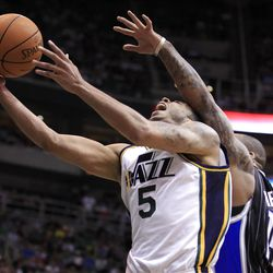 Utah Jazz's Devin Harris, left, is fouled by Orlando Magic's Jameer Nelson during the second half of an NBA basketball game in Salt Lake City, Saturday, April 21, 2012. The Jazz beat the Magic 117-107 in overtime. (AP photo/George Frey)