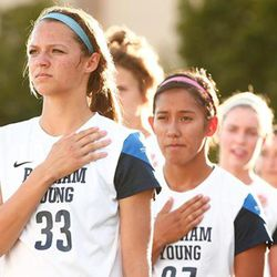 Ashley Hatch salutes the flag before a match at South Field with the BYU women's soccer team.