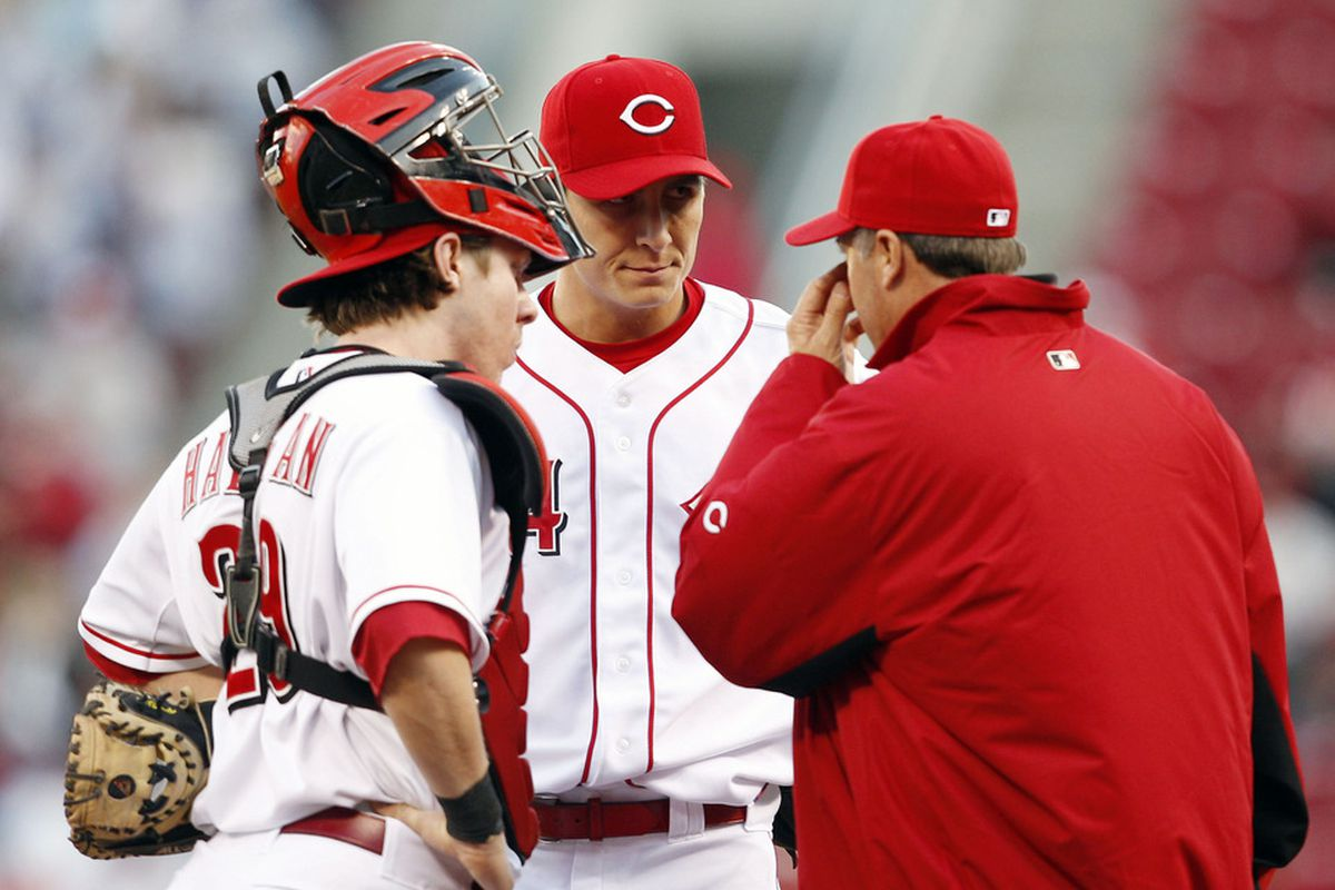 Apr 9, 2012; Cincinnati, OH, USA; Cincinnati Reds pitching coach Bryan Price (38) smells his farts in an attempt to explain to Homer just how much he's stunk so far.
