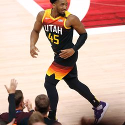 Utah Jazz guard Donovan Mitchell (45) looks back at Memphis Grizzlies forward Dillon Brooks (24) after dropping in a 3-pointer over him as the Utah Jazz and the Memphis Grizzlies play in Game 5 of an NBA basketball first-round playoff series at Vivint Arena in Salt Lake City on Wednesday, June 2, 2021.