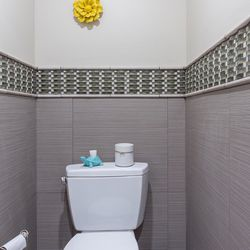 Clients wanted this toilet room, shown before renovation, in the master bathroom to be renovated to accommodate a future walk-in tub. The required plumbing was installed behind the walls and floors to make future installation easy while in the meantime, the space is being used for storage.