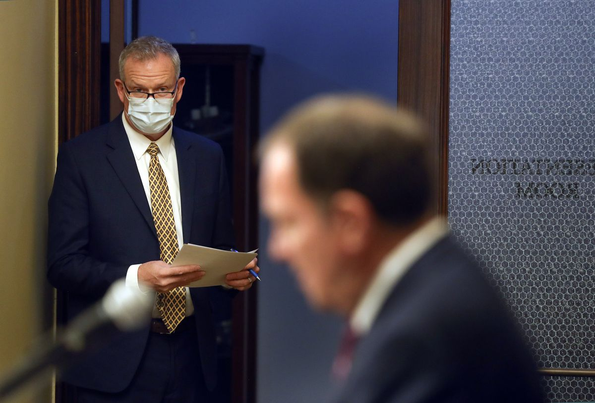 Rich Saunders, interim executive director for the Utah Department of Health, listens as Gov. Gary Herbert talks about the COVID-19 pandemic in Utah during a briefing at the Capitol in Salt Lake City on Thursday, Dec. 17, 2020.