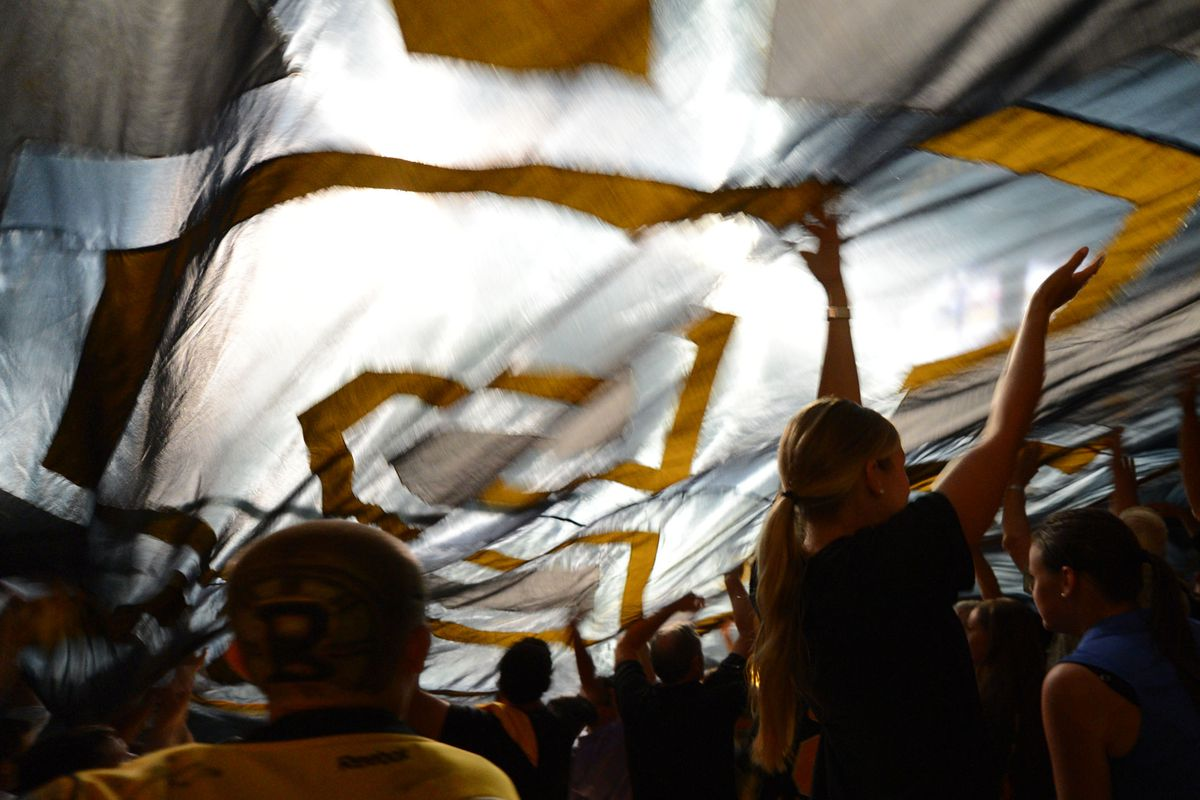 A peek from underneath the passing Bruins flag.
