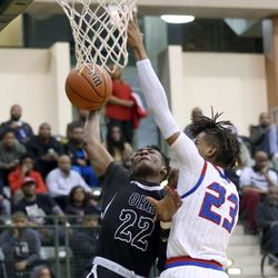 Orr's Tujautae Williams (22) is fouled by Curie's Ramean Hinton (23) in their CPS semi final game at Chicago State University, Friday, February 15, 2019. | Kevin Tanaka/For the Sun Times
