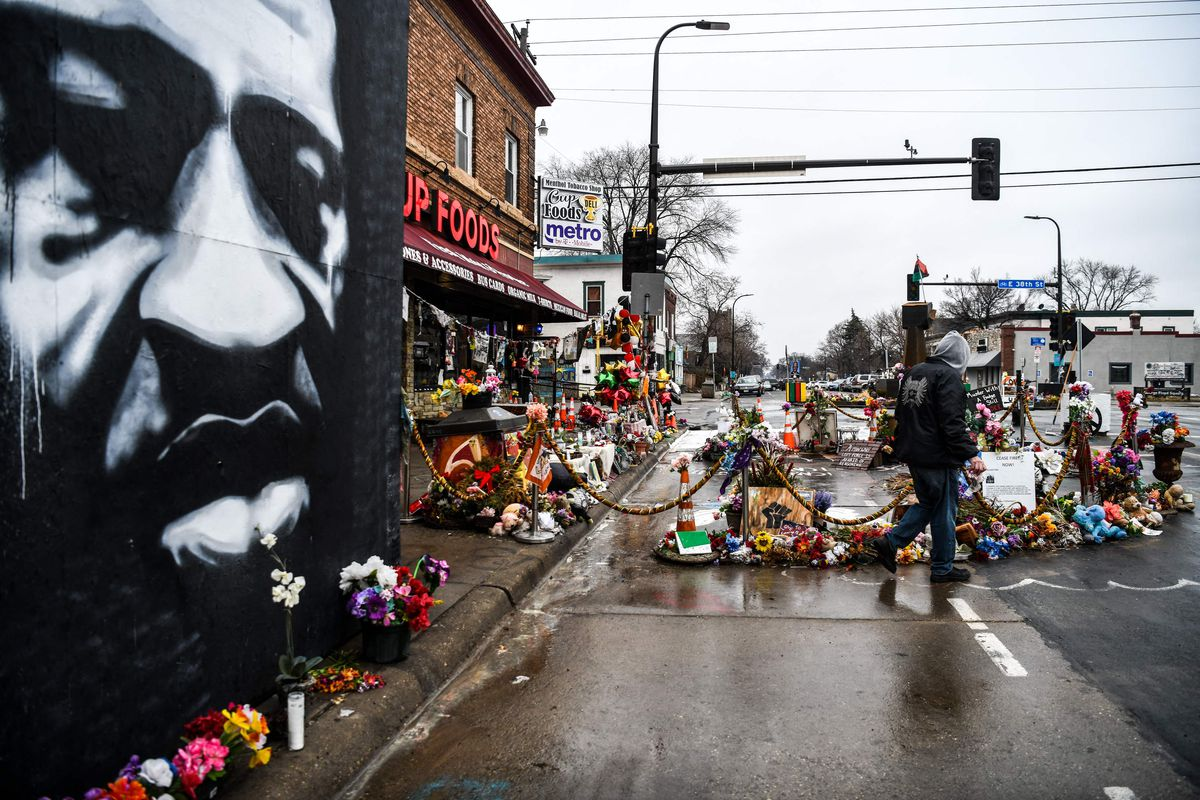 A man walks near the makeshift memorial of George Floyd before the third day of jury selection begins in the trial of former Minneapolis Police officer Derek Chauvin who is accused of killing Floyd, in Minneapolis, Minnesota on March 10, 2021.