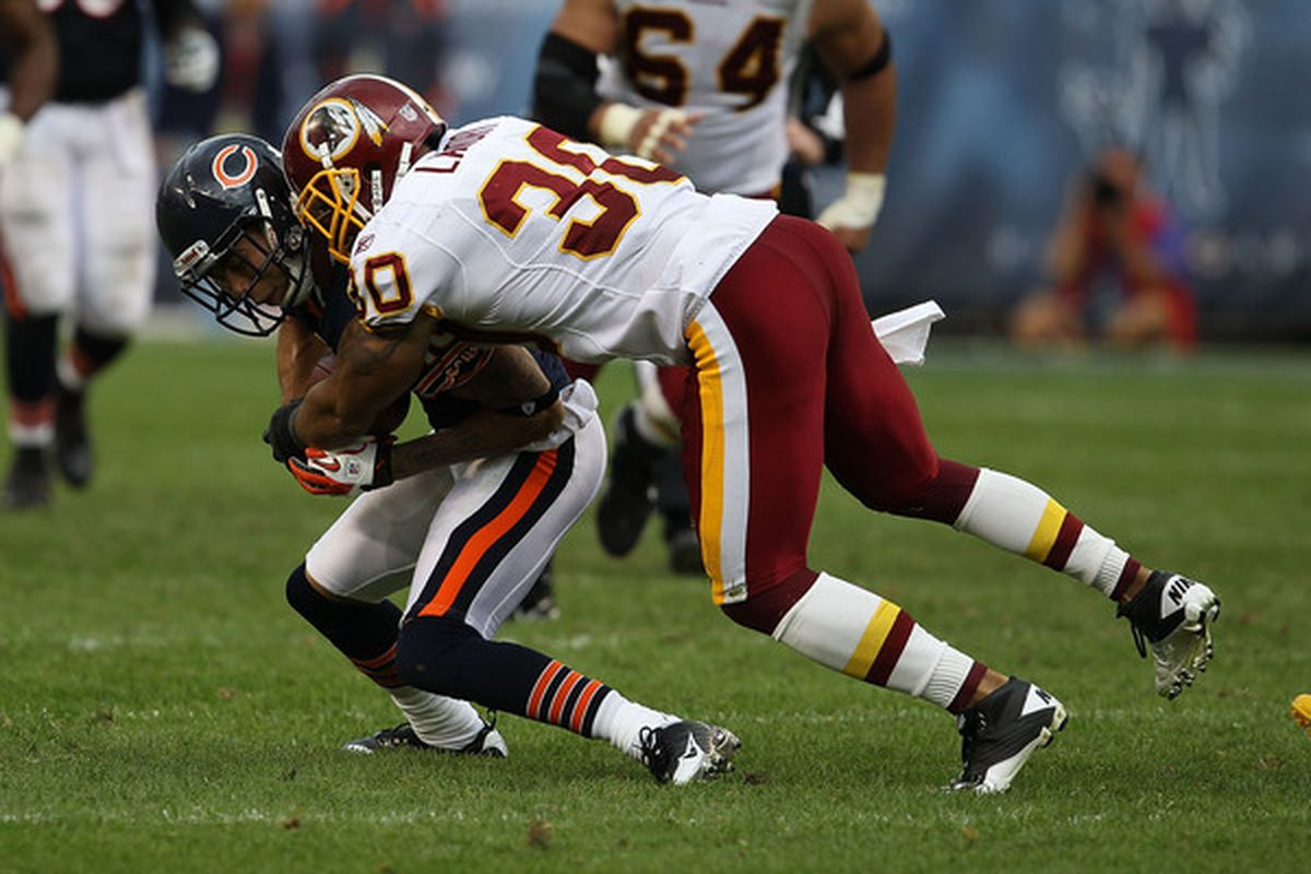 CHICAGO - OCTOBER 24: LaRon Landry #30 of the Washington Redskins tackles Johnny Knox #13 of the Chicago Bears at Soldier Field on October 24 2010 in Chicago Illinois. T(Photo by Jonathan Daniel/Getty Images)