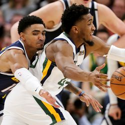 Denver Nuggets guard Gary Harris (14) knocks the ball away from Utah Jazz guard Donovan Mitchell (45) as the Utah Jazz and the Denver Nuggets play an NBA basketball game at Vivint Arena in Salt Lake City on Wednesday, Feb. 5, 2020. Denver won 98-95, giving the Jazz their fifth straight loss.