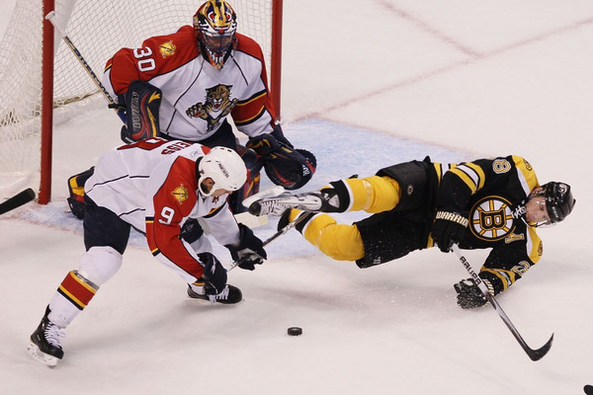 BOSTON - APRIL 01:  Mark Recchi #28 of the Boston Bruins is tripped up by Stephen Weiss #9 of the Florida Panthers as Scott Clemmensen #30 defends on April 1, 2010 at the TD Garden in Boston, Massachusetts.  (Photo by Elsa/Getty Images)
