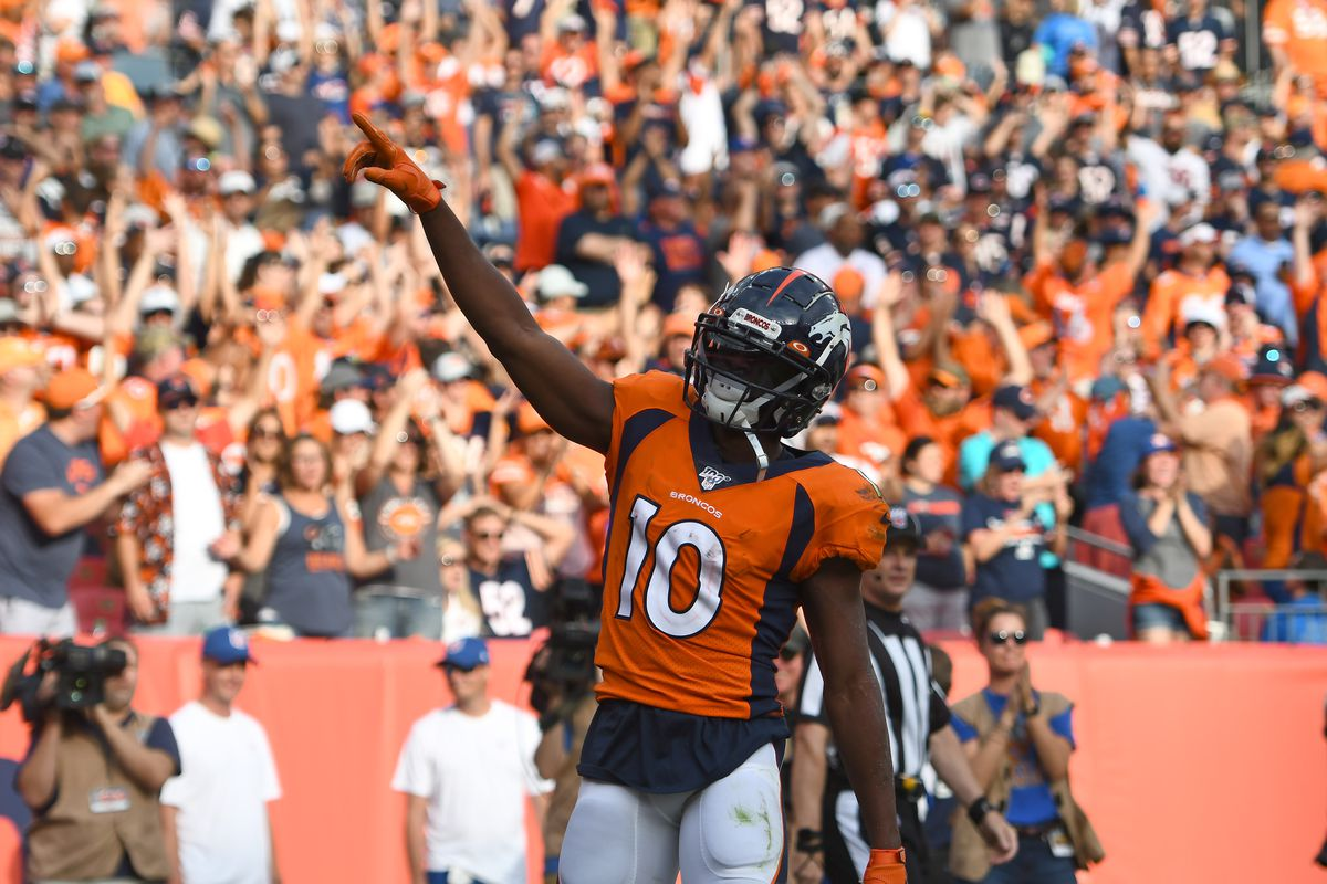 Denver Broncos wide receiver Emmanuel Sanders celebrates his touchdown in the fourth quarter against the Chicago Bears at Empower Field at Mile High.