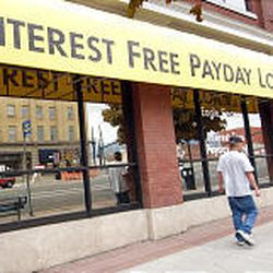 """Some payday lenders advertise """"interest free loans,"""" but they may cost an average of 521 percent annual interest in Utah."""