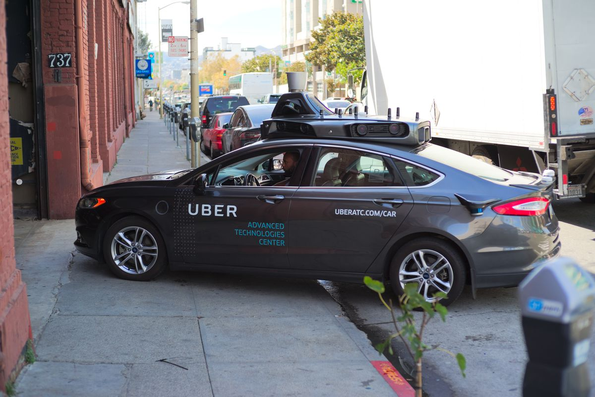 A self-driving Uber car pulling out of the garage.