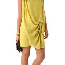 "<a href=""http://www.shopbop.com/sleeveless-drape-front-dress-halston/vp/v=1/845524441941648.htm?folderID=2534374302168683&fm=browse-brand-shopbysize&colorId=12581"">Halston Heritage drape-front dress</a>, $375"