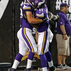 Aug 9, 2013; Minneapolis, MN, USA; Minnesota Vikings running back Zach Line (48) and Minnesota Vikings wide receiver Stephen Burton (11) celebrate after scoring a touchdown in the second quarter against the Houston Texans at the Metrodome.