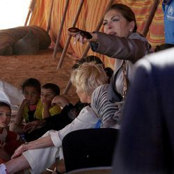 Quentin Bryce, the Australian Governor-General, speaks to Syrian refugee children at the Zaatari Syrian Refugee Camp, in Mafraq, Jordan, Sunday, Sept. 2, 2012. Bryce told the press that Australia has contributed 20 million in funds to support the refugees.