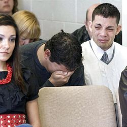 At the parole hearing of Thomas Noffsinger, the sons of Victor Aguilar, Victor (25) and Isaac (20) are overcome with emotion as they listen to the testimony of their mother as she recounts the day she had to tell her family that their father would never come home again. Their sister Liz Aguilar, is pictured at left.