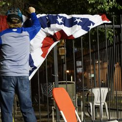 Ballhawk fixes the bunting which had fallen off the fence at Kenmore and Waveland