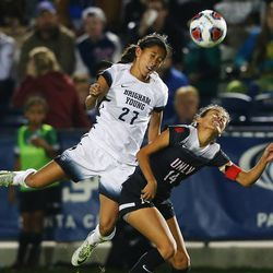 BYU Elena Medeiros (27) goes over the top of UNLV Susie Bernal (14) for the ball as BYU and UNLV play in the first round of the NCAA tournament in Provo on Friday, Nov. 11, 2016.