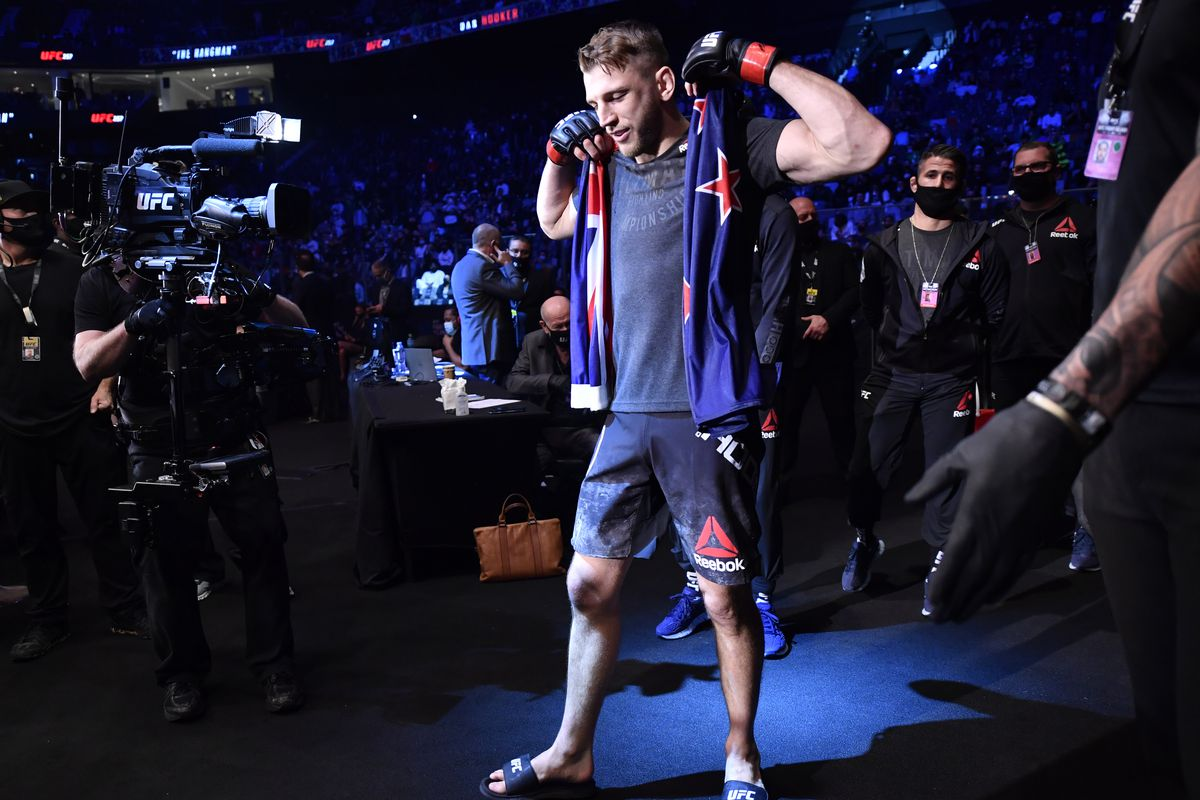 Dan Hooker walks to the cage ahead of his UFC 257 bout against Michael Chandler.