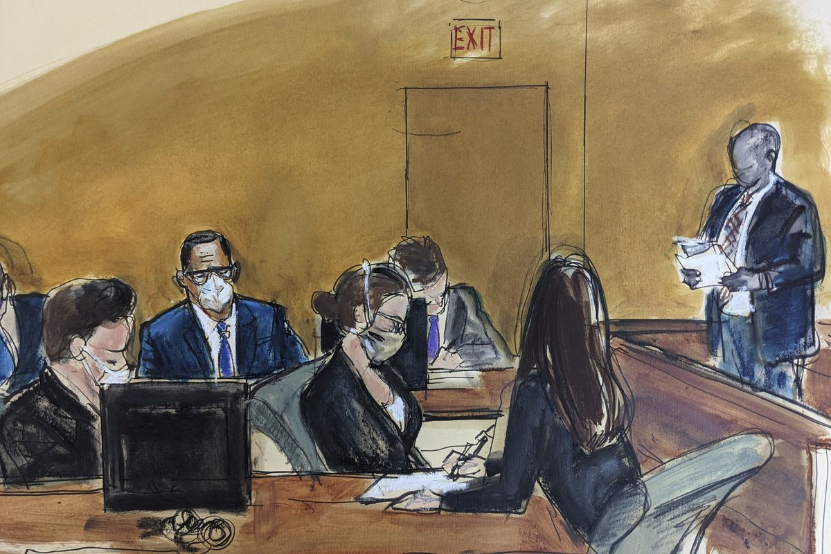 In this courtroom sketch, R. Kelly listens from the middle of defense table (white mask, glasses, blue jacket) while the jury foreperson, far right, reads the verdict, Monday, Sept. 27, 2021, in New York.