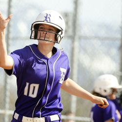Riverton's Kyli Carrell (10) high-fives a teammate after scoring against Murray in a high school girls softball game at Riverview Junior High in Murray on Wednesday, April 7, 2021.