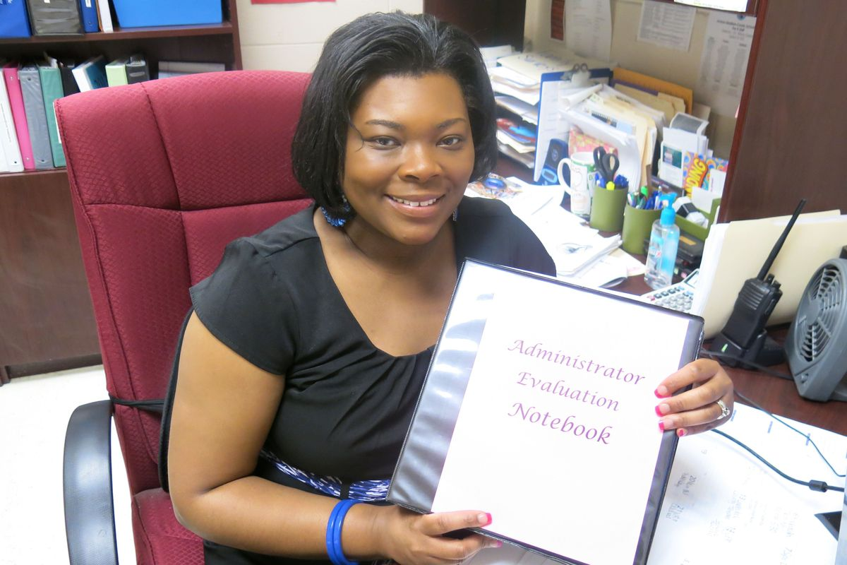 Jackson-Madison County School Principal Tiffany Green holds her Administration Evaluation Notebook, which is used during her principal observation periods.