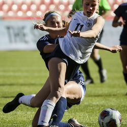 Bonneville's Gabby Carlson (11) collides with Skyline's Lilly Kimball (10) while chasing the ball during the second half of the 5A girls state championship at Rio Tinto Stadium in Sandy on Friday, Oct. 25, 2019. Skyline defeated Bonneville in overtime 2-1 to take home the state title.