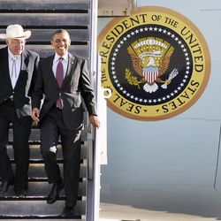 President Barack Obama, right, and Secretary of the Interior Ken Salazar, left, exit Air Force One at the Roswell International Air Center in Roswell, N.M., Wednesday, March 21, 2012.