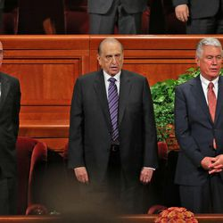 President Thomas S. Monson, with counselors President Henry B. Eyring, left, and President Dieter F. Uchtdorf, right, sing at the morning session of the 183rd Semiannual General Conference of the Church of Jesus Christ of Latter-day Saints Sunday, Oct. 6, 2013, in Salt Lake City.