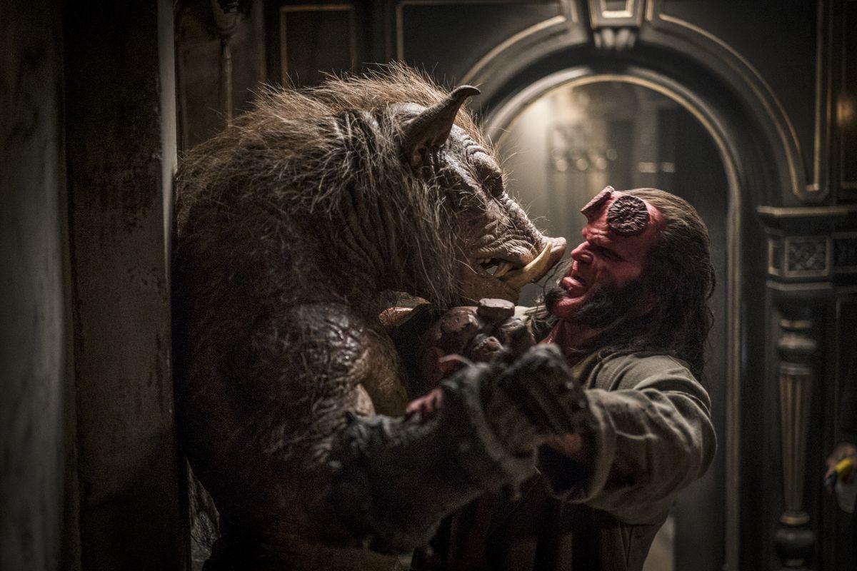 a pig minotaur dances with hellboy in Hellboy (2019)