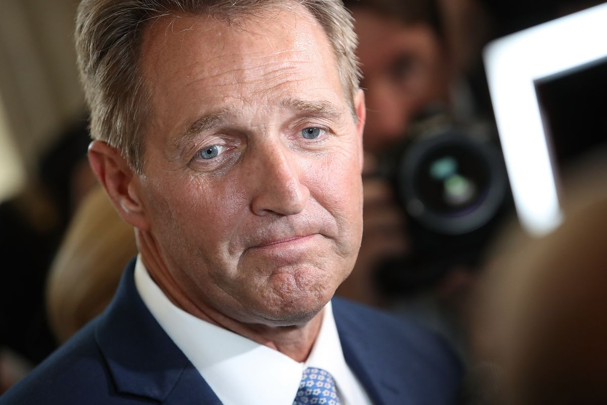 Sen. Jeff Flake (R-Ariz.) speaks to reporters on Capitol Hill after announcing that he will not seek reelection.