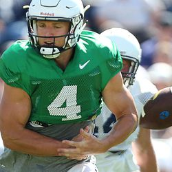 BYU football QB Taysom Hill drops the ball during a scrimmage at BYU in Provo on Saturday, Aug. 15, 2015.