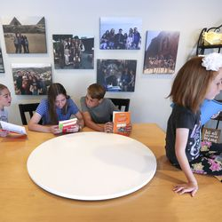 Katrina, left, Maria, John and Rebekah Hilton work together from their Chinese language books in their home in Orem on Thursday, June 25, 2020. The four siblings attend dual language immersion schools.