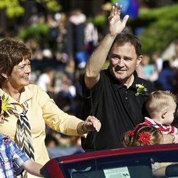 Utah Governor Gary Herbert waves to the crowds gathered to watch the Days of '47 Parade in Salt Lake City Saturday.