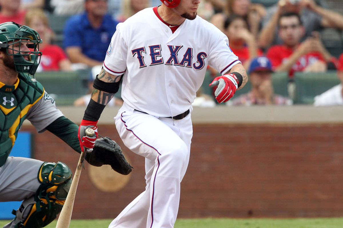 ARLINGTON, TX - JULY 1: Josh Hamilton #32 of the Texas Rangers puts the ball into play against the Oakland Athletics on July 1, 2012 at the Rangers Ballpark in Arlington in Arlington, Texas. (Photo by Layne Murdoch/Getty Images)