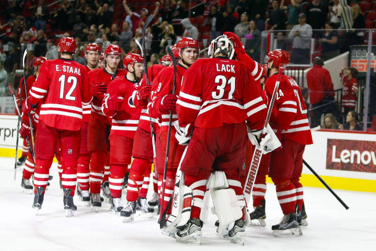 The Canes congratulate Eddie Lack after beating the Capitals, 4-3 in a shootout on Wednesday night.