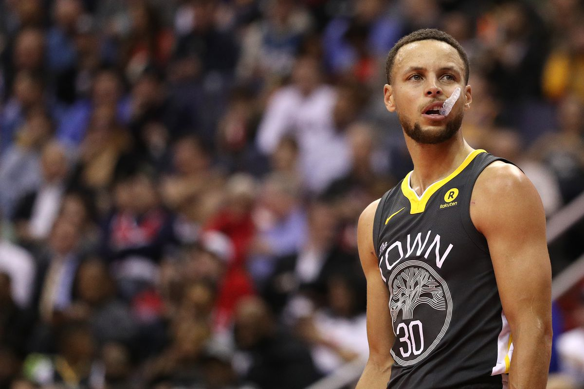 Stephen Curry biting his mouthguard