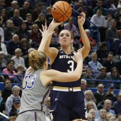 Notre Dame's Marina Mabrey (3) shoots a three over UConn's Katie Lou Samuelson (33) during the Notre Dame Fighting Irish vs UConn Huskies women's college basketball game in the Women's Jimmy V Classic at the XL Center in Hartford, CT on December 3, 2017.