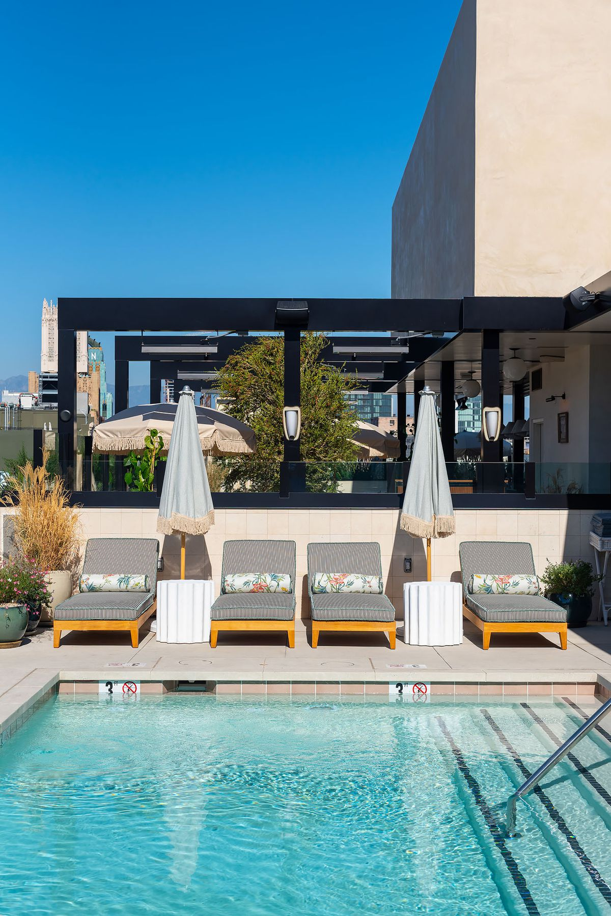 Lounge seating at a rooftop pool.
