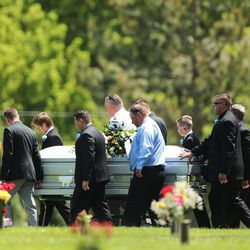 The casket of Memorez Rackley and her son, Jase, is taken to the gravesite at Memorial Redwood Mortuary and Cemetery in West Jordan on Tuesday, June 20, 2017.