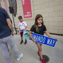 Benny Rose Rimando carries a street sign with her dad's name on it as Real Salt Lake honors goalkeeper Nick Rimando during a ceremony at Rio Tinto Stadium in Sandy on Friday, Sept. 27, 2019. Rimando will play his last home game on Sunday.