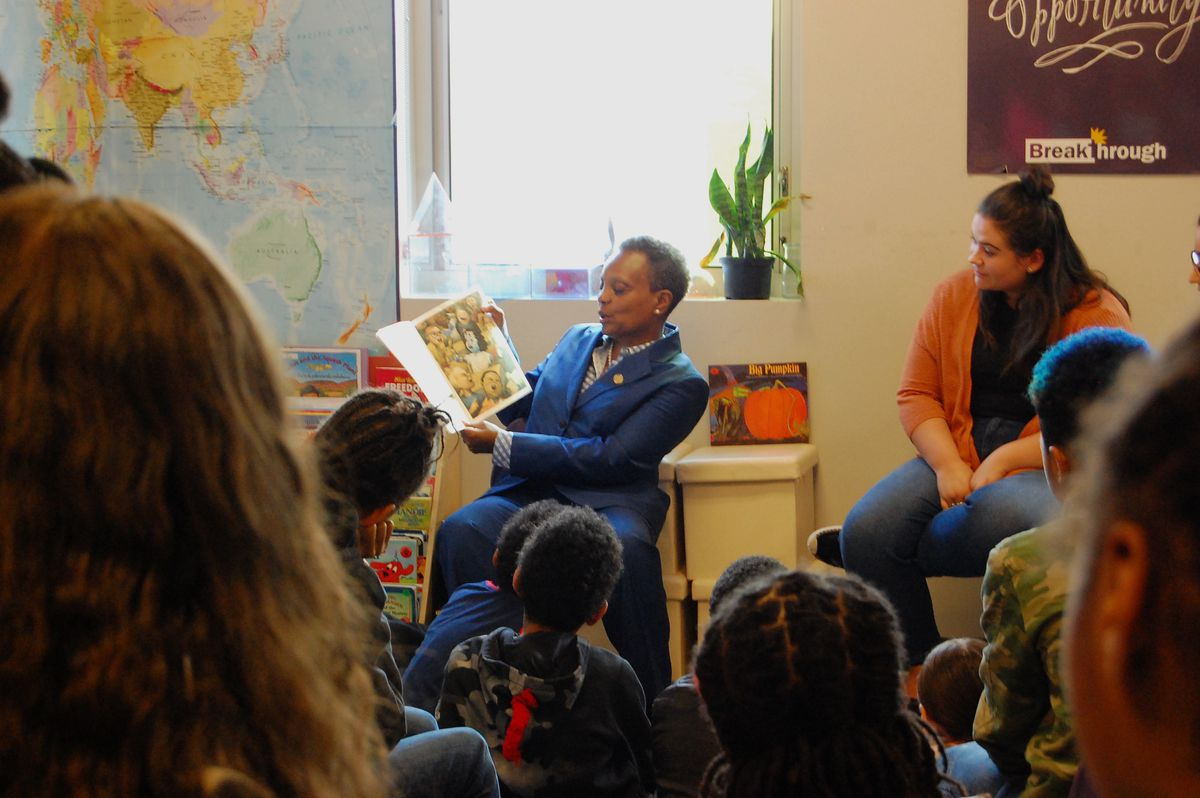 Mayor Lori Lightfoot reads to students on the first morning of Chicago's teachers strike.